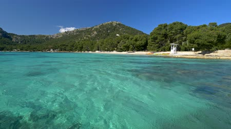 baleár : Beautiful beach with turquoise water in Mallorca, Spain. Classical beach of Balearic Islands Stock mozgókép
