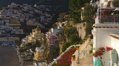 costiera amalfitana : Panorama of the sea, the rock, the church, and beautiful colorful houses on Amalfi coast in Positano village in Campania, Italy. Crane shot, 4K Filmati Stock
