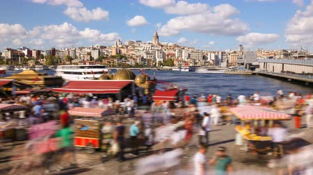turecko : Timelapse of people walking around famoust tourist place in Istanbul with Galata Tower view and Bosphorus