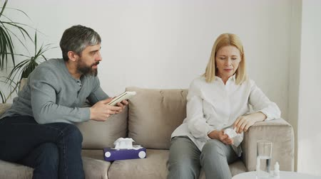 cheerless : Crying stressed woman talking with professional male psychologist who gives paper tissue and trying to calm down her during thearpy session Stock Footage
