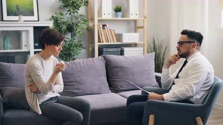 listener : Unhappy young lady patient is crying talking to therapist in psychological clinic expressing grief and unhappiness. Feelings, youth and support concept. Stock Footage