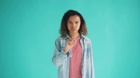 denying : Portrait of attractive African American lady waving finger and shaking head meaning no standing on bright blue background. Youth, human reactions and people concept.
