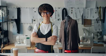 manequim : Portrait of happy young lady fashion designer smiling standing in workshop alone looking at camera. Small business owner and successful youth concept. Stock Footage