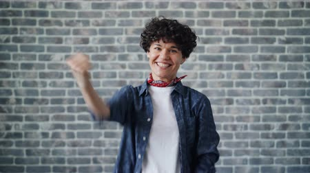 raising fist : Portrait of excited young woman raising fists celebrating success and luck expressing positive emotions. Successful people, happiness and excitement concept.