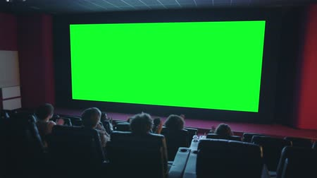 theater hall : Slow motion of happy viewers crowd clapping hands looking at green chroma key cinema screen expressing admiration. Business, movie theater and emotions concept. Stock Footage