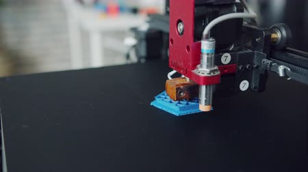Close-up of modern 3d printer manufacturing three-dimensional plastic model in laboratory. Contemporary devices, business and innovation concept.