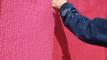 rolete : Painting of pink wall with paint roller