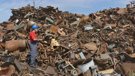 destruct : Metal recycling, worker using phone to calculate price and quantity Stock Footage
