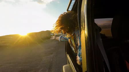 positive vibes : beautiful woman with head outside the window car