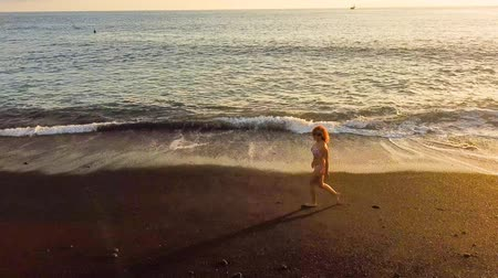 positive vibes : caucasian woman walking on the shore of atlantic ocean Stock Footage