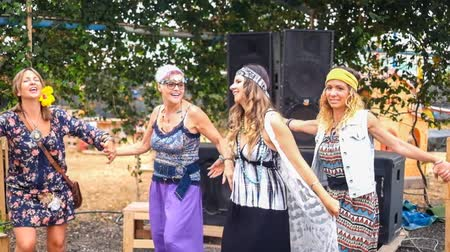 positive vibes : group of best friends women dancing hippie style