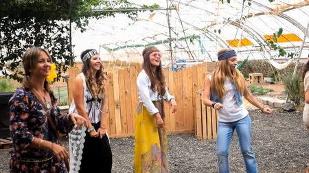 positive vibes : five young women dancing and laughing together in friendship