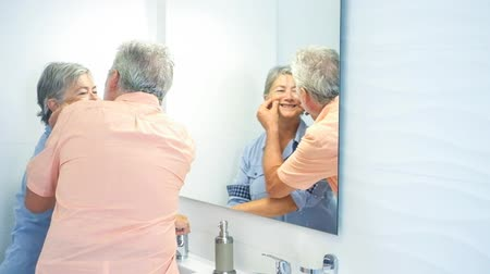 positive vibes : senior couple with gray hair and casual clothes in the bathroom