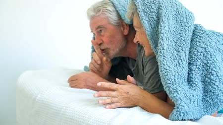 positive vibes : Senior couple playing under a blanket Stock Footage