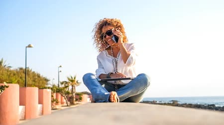 svatozář : Beautiful woman with laptop and mobile phone at the beach