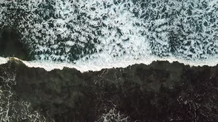 sun down : Aerial view of waves and rocks of the atlantic ocean Stock Footage