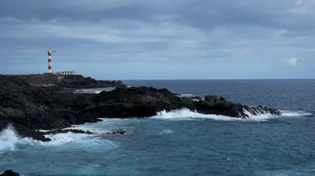 latarnia morska : Lighthouse at the horizon on Tenerife south coastline