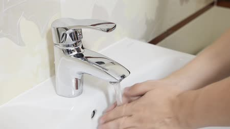 Man washing hands in bathroom. Utilities water bill cost rise hand wash composition Vídeos