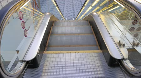 aşağı : 4K Movie - Escalator in modern office building Stok Video
