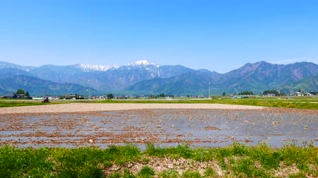 Mountains to reflect before rice planting car moving.