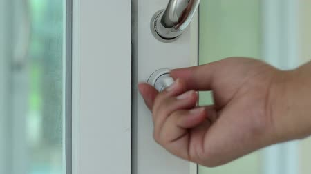 Дверная ручка : Close up opening door with hand