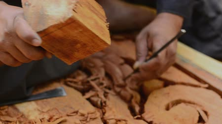 madeira : Close up wood carver working