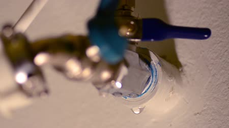leaking : repairing faucet Stock Footage