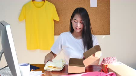 sme : Online seller business woman packing product for sending to customer
