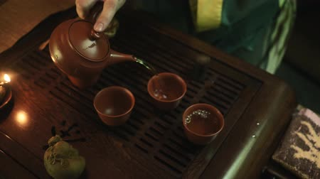traditional ceremony : Traditional chinese tea ceremony on the tea table, close up, slow motion, dolly shot