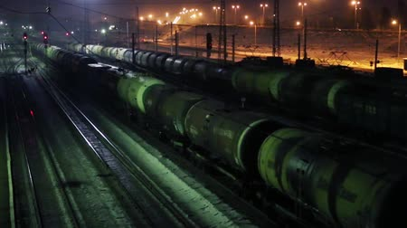 editorial : PERM, RUSSIA - MAR 7, 2015: Long freight trains move on railway at winter night Stock Footage