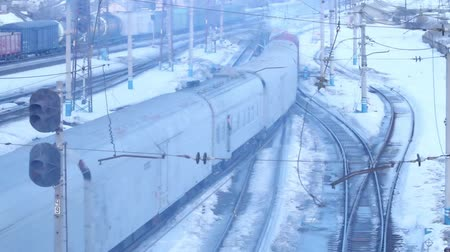 modern train wagon : Moving small freight train on railway at winter day Stock Footage