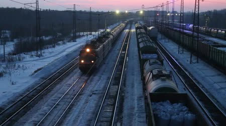 modern train wagon : Moving long freight train on railway at winter evening