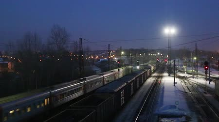 modern train wagon : Moving long freight train on railway at winter night