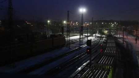 vasúti : Long freight trains move on railway at winter night Stock mozgókép