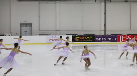 üdvözlettel : PERM, RUSSIA - DEC 28, 2016: Girls perform at the Open Cup of the Region in synchronized skating in Sports Palace Eaglet