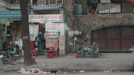 vietnamec : Ho Chi Minh City, Vietnam - Feb. 03, 2018: People Eating on Street of Saigon