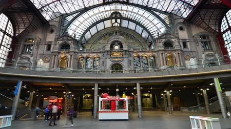 belga : Antwerp Belgium  May 11 2015: People in hall of Antwerp Central station on May 11 2015 in Antwerp Belgium. The station is widely regarded as the finest example of railway architecture in Belgium.