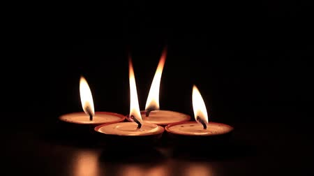 освещенный : Four butter lamps or wax candles, used in Diwali or Deepawali, 1080p, 60fps Стоковые видеозаписи