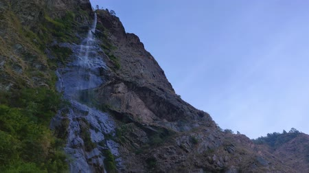 remote location : Long waterfall on a rocky mountain in remote location of Nepal. Manaslu Conservation Area