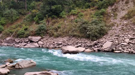 rural area : Blue river flowing in the middle of mountains