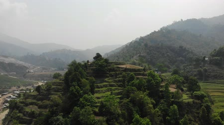 remote location : Terrace farming, hills and green forest in Nepal. 4K video Stock Footage
