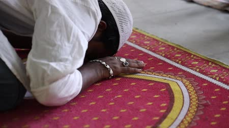 dua eden : Asian Muslim people offering prayer at a mosque.