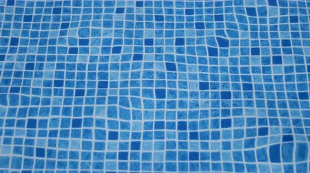 Swimming pool checkered of a design or pattern background 4K pure blue water