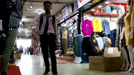 Kathmandu, Nepal - September 8 2019: Consumers walking past shops in a mall