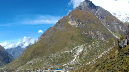 remote location : Rocky green hill in Langtang valley Nepal Stock Footage