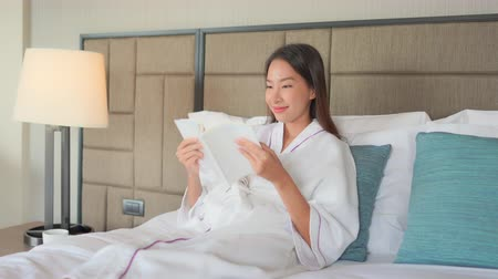 knitted : Women reading book in bed