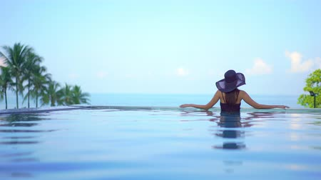serene : Women around swimming pool in resort for relax in vacation