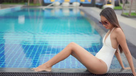 харизматический : Women around swimming pool in resort for relax in vacation