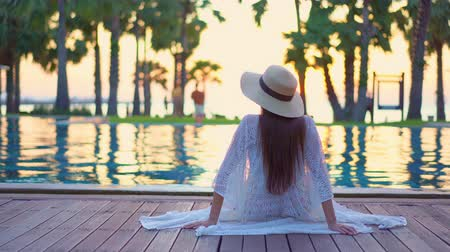 charisma : Women around swimming pool in resort for relax in vacation