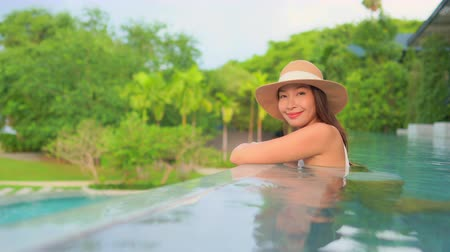 csempe : Women around swimming pool in resort for relax in vacation